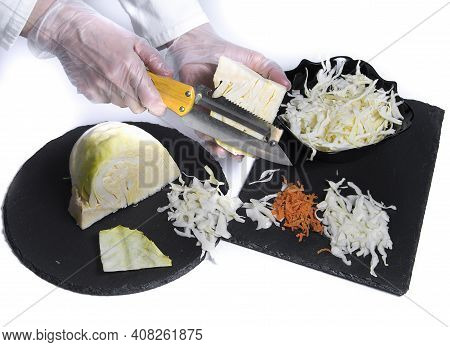 Closeup Of Women's Hands With Chopping Knife Chop Cabbage On The Cutting Board Preparing Slaw Salad