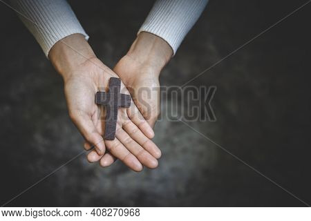 Human Hand Holds Cross, Worship, Sins And Prayer, Religious Concept. Eucharist Therapy Bless God Hel