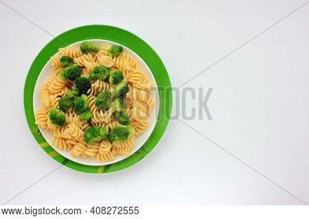 Fusilli Pasta With Broccoli In Garnish Dish On White Background. Overhead View Of Vegetable Pasta Wi