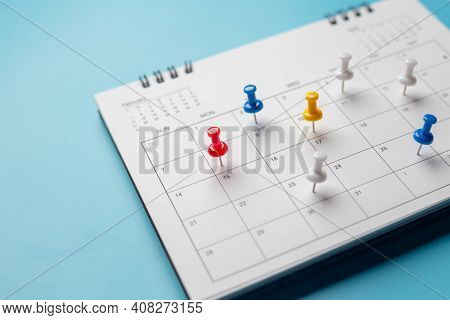Calendar On Solid ิblue Background With Copy Space, Pinned In A Calender On Datebusiness Meeting Sch