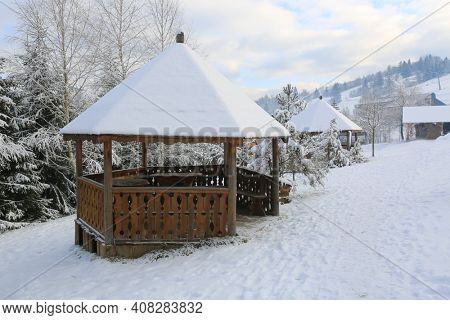 wooden gazebo in winter mountain park, Carpathian, Ukraine