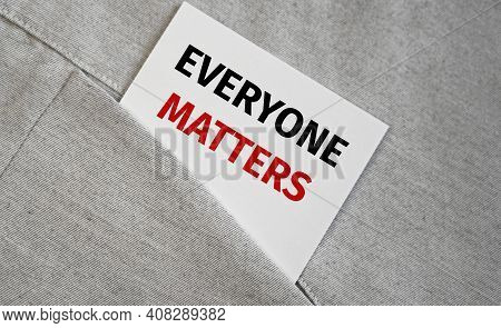 Everyone Matters Text On A Sticker In A Pocket.