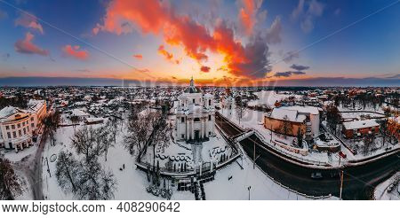 Panoramic Aerial View Of The Cathedral And Church In Snow-covered Small European City At Bright Wint