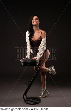 Slim Woman In Lingerie Standing In Studio