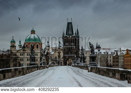Winter View Of Charles Bridge, Old Town Bridge Tower Covered With Snow, Prague, Czech Republic. Peop