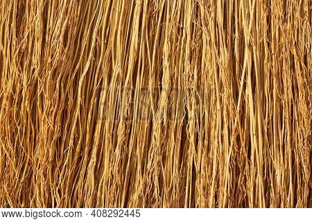 A Straw Broom. Straw Texture Close-up. Flax Straw