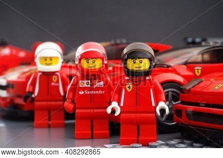 Tambov, Russian Federation - February 14, 2021 Lego Ferrari Driver Minifigures Standing Near Their L
