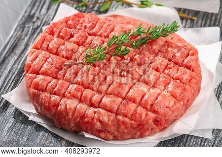 Raw Minced Beef Patties For Burgers. Raw Meat For Hamburgers. Beef Cutlets.