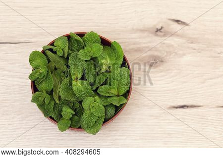 Wooden Bowl  And Fresh Mint Leaves, Close Up