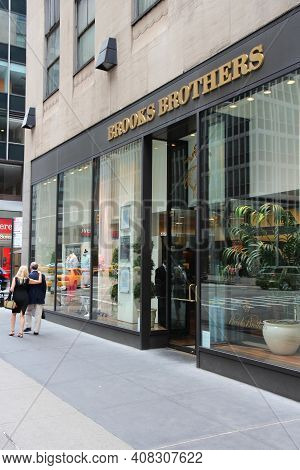New York, Usa - July 4, 2013: People Walk By Brooks Brothers Fashion Store In 6th Avenue, New York.