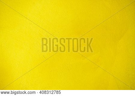 Yellow Cement Texture Or Concrete Wall For The Background. High Resolution Through A Retouching Proc