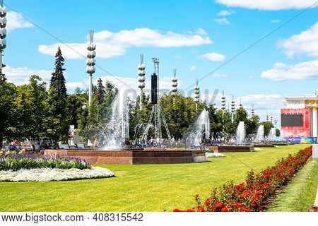 Moscow, Russia - July 29, 2019: Fountain And Park In Vdnh Sunny Summer Day, Popular Tourist Landmark