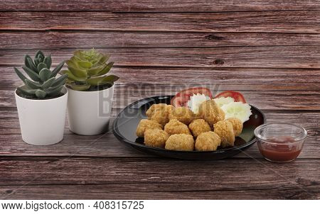 Chicken Nuggets Isolated On A Wooden Blackground