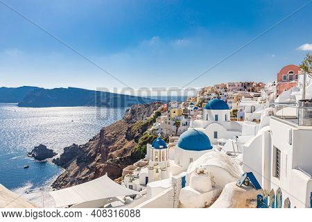 Famous Blue Dome Churches In Oia, (santorini, Greece) In The Morning. White Architecture Of Oia Vill