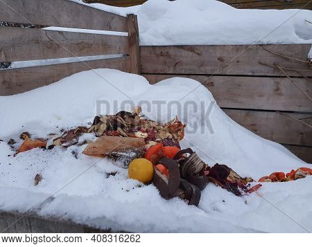 Wood Compost Bin In Winter, Food Waste Composted. Lets Protect Nature Concept, Ecological Composting