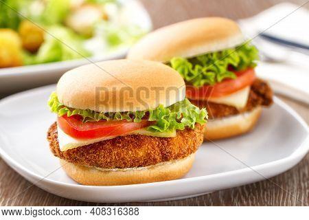 Mini Crispy Chicken Burger With Lettuce Tomato And Cheese.