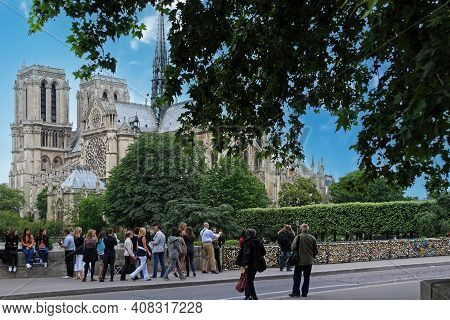 Paris, France, June 19: Tourists On The Bridge Of The Archdiocese On June 19, 2012 In Paris, In The