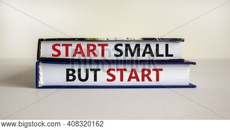 Start Small But Start Symbol. Concept Words 'start Small But Start' On Books On A Beautiful White Ba