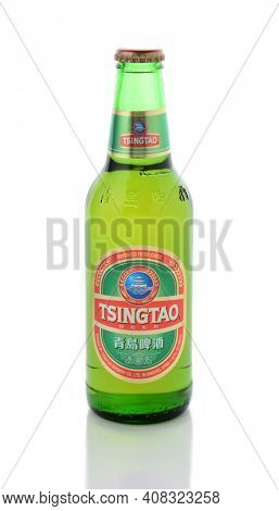 IRVINE, CA - JANUARY 15, 2015: A bottle of Tsingtao Beer. Tsingtao is China's second largest brewery, it was founded in 1903 by German settlers.