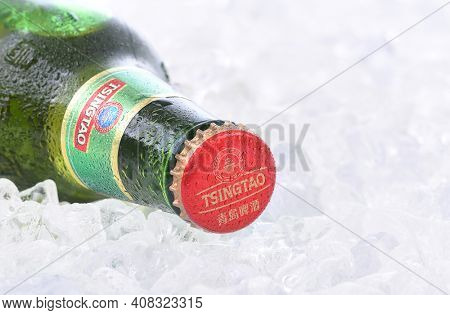 IRVINE, CA - AUGUST 26, 2016: A bottle of Tsingtao Beer. Tsingtao is China's second largest brewery, it was founded in 1903 by German settlers.