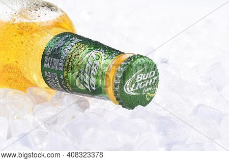 IRVINE, CA - APRIL 10, 2017: Bud Light Lime Bottle on Ice. From Anheuser-Busch InBev, Bud Light Lime is a flavored beer introduced in 2008.