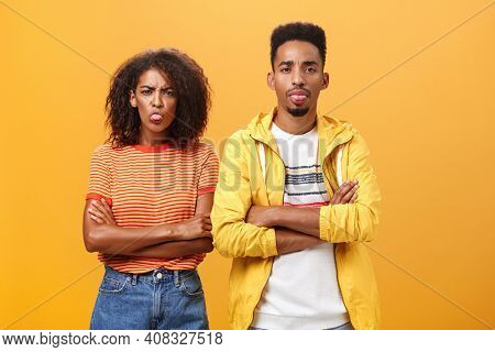 Indoor Shot Of African American Siblings Being Displeased And Annoyed Showing Bad Tempber Behaving C
