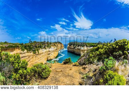 Small picturesque bay with green ocean water. The Pacific ocean. The Great Ocean Road of Australia. The concept of exotic, active and photo-tourism