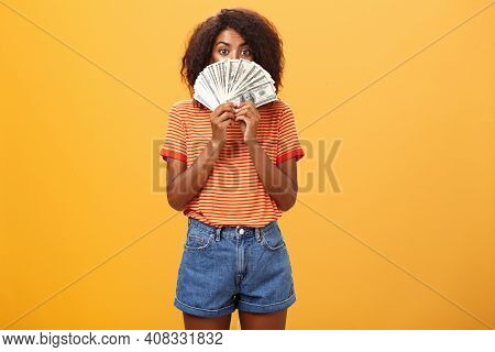 Woman Gonna Waste Lots Of Cash Today. Pleased And Delighted Rich African American Girl With Curly Ha