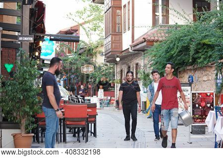 05.11.2019 - Antalya, Turkey. People Are Walking At The Narrow Cobbled Street. Narrow Street With Tr