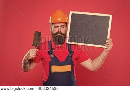 Renovation Company Services. Professional Plasterer. Skillful Plasterer. Bearded Man Worker With Pla