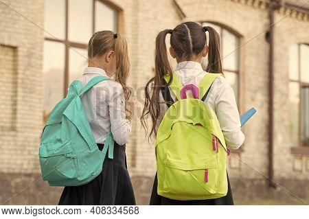 Study And Spread Knowledge. Little Children Carry Heavy Backpacks. Knowledge Day. Back To School. Ed