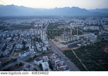 Panoramic View Of Antalya Town Landscape With Mosque Minaret View. Cityscape Of Antalya With Blue Mo