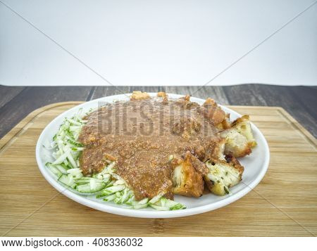 Indian Rojak With Fried Shrimp Fritters, Tofu, Egg, Shredded Cucumber And Turnip With Sweet And Spic
