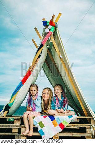 Mom With Children Girl In Tent. Summer Outdoor. Family Playing Together. Happy Mother Laughing With