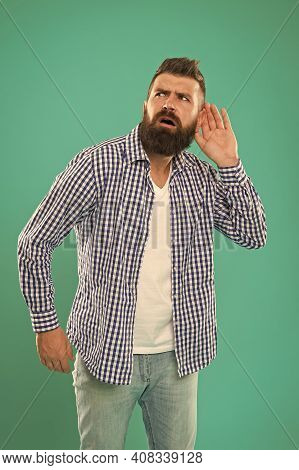 Bearded Man Concentrated On Listening. Hearing Problems. What. Eavesdrop On Conversations. Deafness