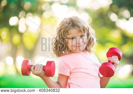 Kid Workout. Child Exercising With Dumbbells. Sporty Child With Dumbbell Outdoor. Kids Sport. Boy Wo
