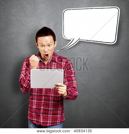 Asian man with speech bubble and touch pad in his hands got bad news