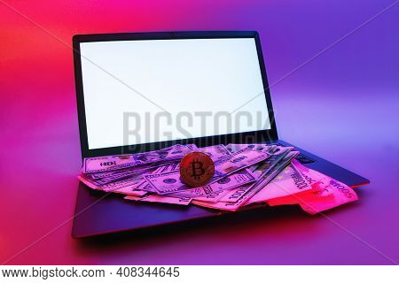 Mock Up Laptop With White Screen And Cryptocurrency Bitcoin, Dollars And Euros Against A Background
