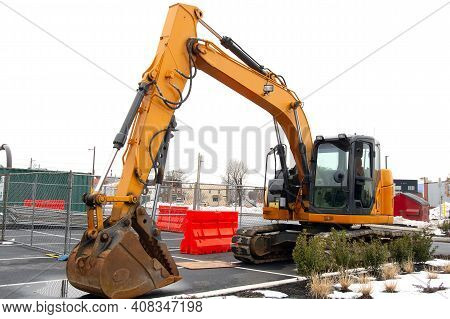 Yellow Excavator On A Construction Site Heavy Shovel