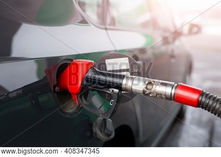 Refueling A Car With Gasoline Or Diesel Fuel At A Gas Station. Fuel Filling Station. Handle Fuel Noz
