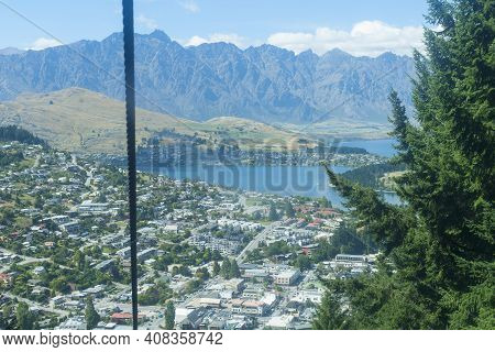 View From Bob's Peak Above Queenstown With Gondola Wire Cable And Township And Lake Wakatipu Below.