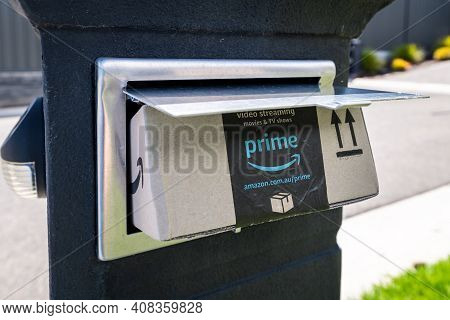 Adelaide, South Australia - February 16, 2021: Small Parcel Delivered Straight Into Mailbox By Amazo