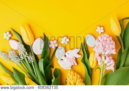 Easter Gingerbread With Icing, Seasonal Flowers On Yellow Table, Festive Easter Background Web Banne