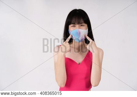 Studio Shot Of Asian Woman Wearing Protective Face Covering For Safety During Coronavirus Pandemic,
