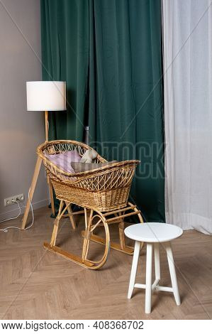 Interior, Wicker Cradle By The Window With Green Curtains