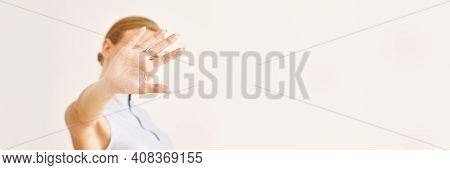 Young Woman Hide Face By Hand. Selective Focus. Stop Paparazzi. Faceless Trendy Female Portrait. Unr