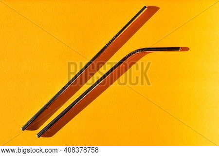 Reusable Metal Straws On Yellow Background - Stainless Steel, Eco-friendly Drinking Straw Set.