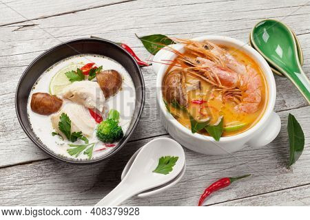 Tom Yum and Tom Kha traditional Thai soups with seafood, chicken, mushrooms, coconut milk and hot spices