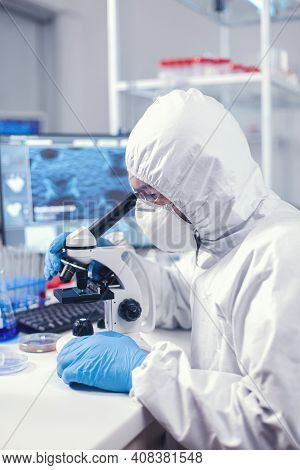 Scientist Using Modern Laboratory Equipment Dressed In Protection Against Covid19. Virolog In Covera