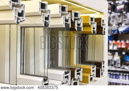 Cutaway Plastic Windows. Pvc Window Profiles Are In Row In Hardware Store. Close-up Of Reinforced-pl